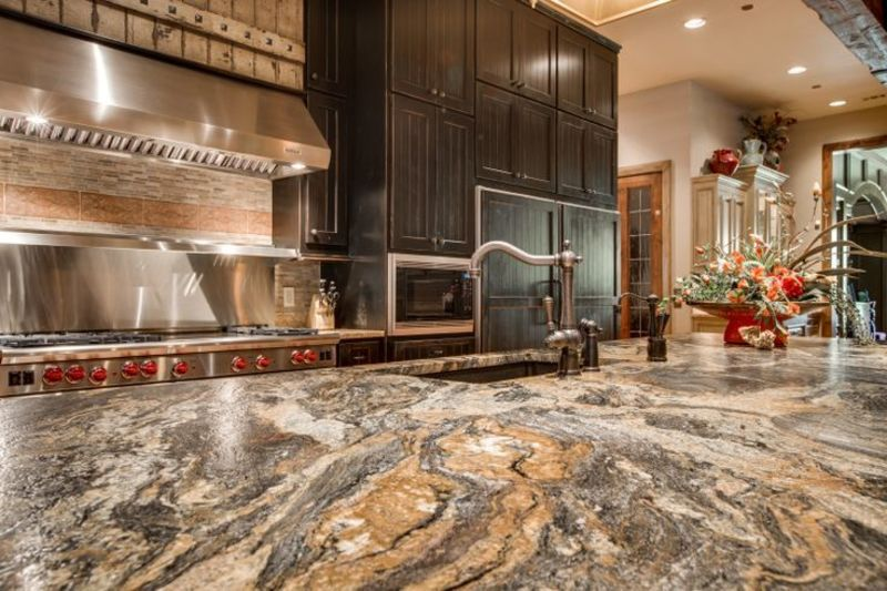 Rustic Stone Countertops : Volcano granite in a leather finish makes this rustic chic