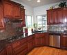 Tile Backsplash, Granite Countertop & Oak Colored Cupboards
