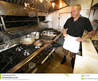 Chef At Work In Small Kitchen Royalty Free Stock Image
