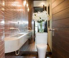 Modern Small Bathroom Design With Wall Mounted Sink And Mirror And Toilet And Flower Glass Vase And Pendant Lights And Recessed Lighting