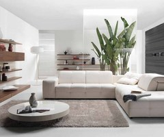 Awesome Modern Living Room Interior Design Styles Trend Decoration With White Leather Sectional Sofa Plus Round Shiny White Laminated Low Coffee Table Also Varnished Wooden Floating Tv Cabinet Table And Wall Shelf Mounted On White Walls As Well As Grey Ru