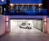 Luxury White Garage On The Basement Paired With Large Storage With Bright Lighting